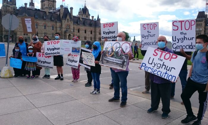 Protesters rally against the 2022 Beijing Winter Olympics at Parliament Hill in Ottawa on June 23, 2021. (NTD Television)