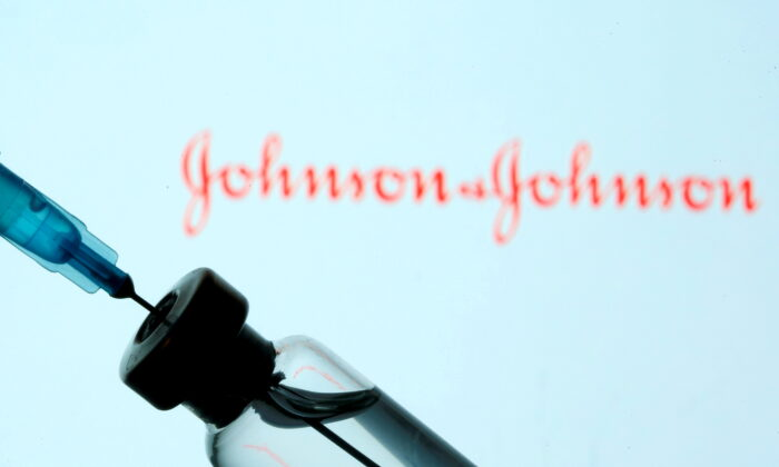 A vial and syringe are seen in front of a displayed Johnson & Johnson logo in this illustration taken on Jan. 11, 2021. (Dado Ruvic/Illustration/Reuters)