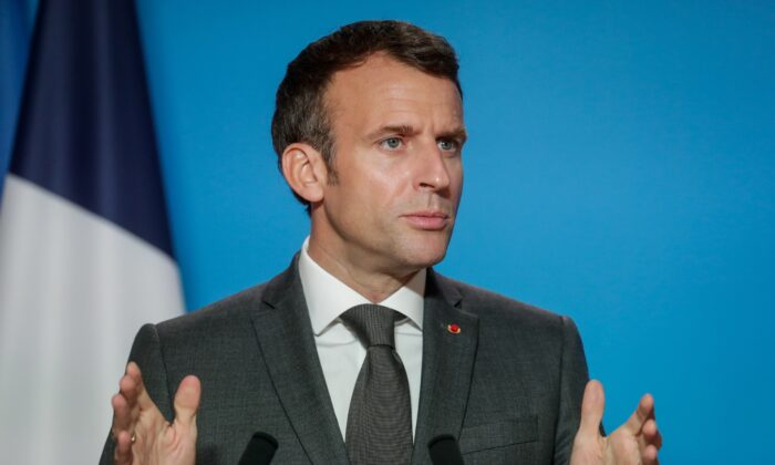French President Emmanuel Macron gives a press conference on the second day of a EU summit at the European Council building in Brussels, Belgium June 25, 2021. Stephanie Lecocq/Pool via REUTERS