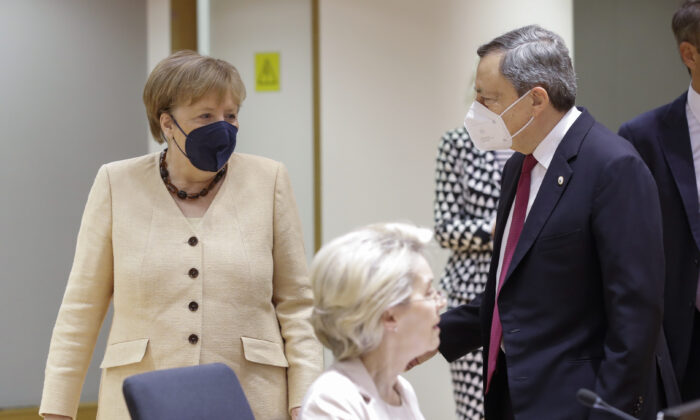 German Chancellor Angela Merkel, left, talks to Italian Prime Minister Mario Draghi during an EU summit at the European Council building in Brussels, on June 25, 2021. (Olivier Hoslet/Pool Photo via AP)