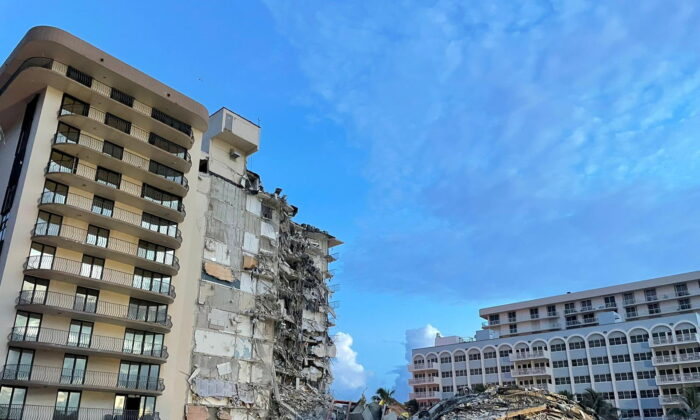 A partially collapsed building in Surfside, near Miami Beach, Fla., on June 25, 2021. (Miami-Dade Fire Rescue Department/Handout via Reuters)