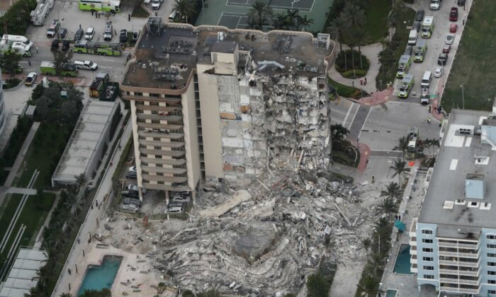 This aerial photo shows part of the 12-story oceanfront Champlain Towers South Condo that collapsed in Surfside, Fla., early on June 24, 2021. (Amy Beth Bennett/South Florida Sun-Sentinel via AP)