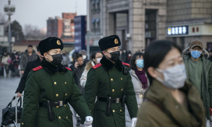 Chinese police officers patrol in Beijing, on Jan. 22, 2020. (Kevin Frayer/Getty Images)