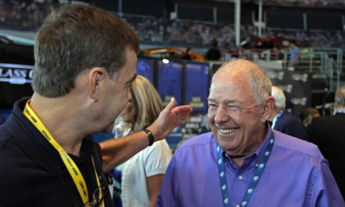 Jack Ingram, right, is congratulated by a guest after being named to the next class of inductees during an announcement at the NASCAR Hall of Fame in Charlotte, N.C., on May 22, 2013. (Chuck Burton/AP Photo)