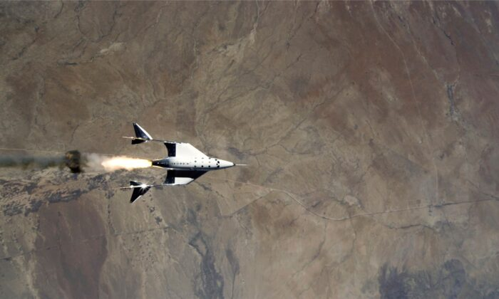 The release of VSS Unity from VMS Eve and ignition of rocket motor over Spaceport America, N.M., on May 22, 2021. (Virgin Galactic via AP)