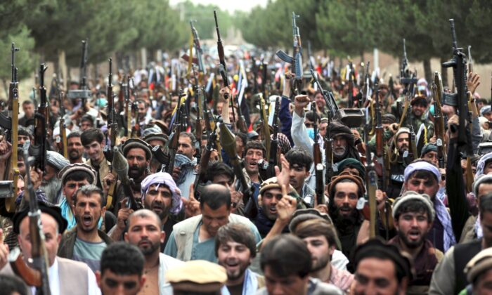 Afghan militiamen join Afghan defense and security forces during a gathering in Kabul, Afghanistan, on June 23, 2021. (Rahmat Gul/AP Photo)