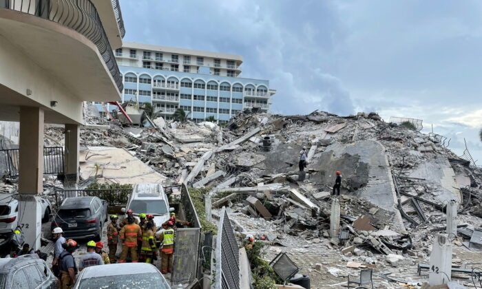 Emergency personnel at the site of a partially collapsed building in Surfside, near Miami Beach, Fla., on June 25, 2021. (Miami-Dade Fire Rescue Department/Handout via REUTERS)