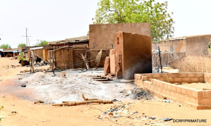 A view shows damaged buildings and huts at the site of an attack in the village of Solhan, in Yagha province bordering Niger, Burkina Faso, on June 7, 2021. (Burkina Faso Prime Minister's Press Service/Handout via Reuters)