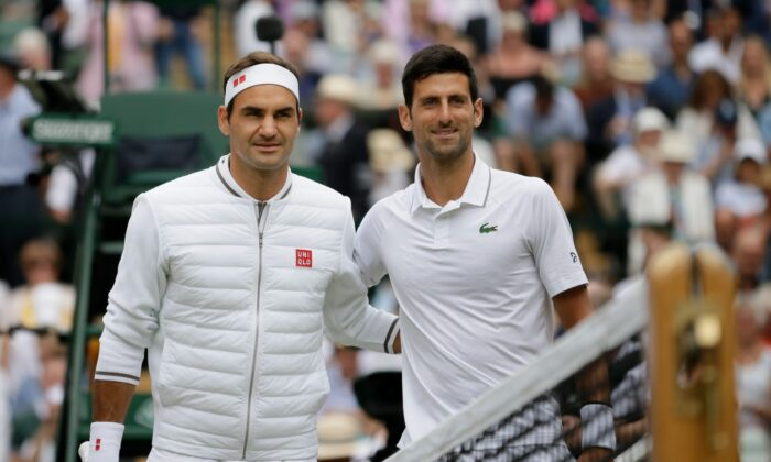 Switzerland's Roger Federer (L) and Serbia's Novak Djokovic poses before the men's singles final match of the Wimbledon Tennis Championships in London, on July 14, 2019. (Tim Ireland/File/AP Photo)