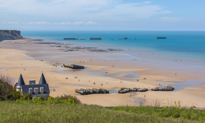 Arromanches-les-Bains beach with the remains of the Mulberry harbor in Normandy, France. (Shandarov Arkadii/Shutterstock)