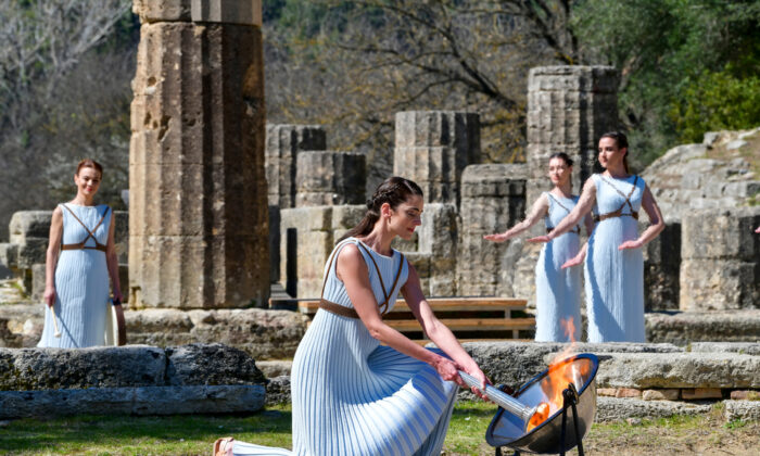 The Olympic flame handover ceremony for the Tokyo 2020 Summer Olympic Games at the ancient Olympia site, birthplace of the ancient Olympics in southern Greece. (Ververidis Vasilis/Shutterstock)