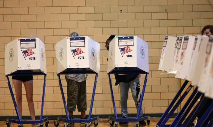 People vote on primary election day at P.S. 249 The Caton School in the Flatbush neighborhood of Brooklyn in New York City on June 22, 2021. (Michael M. Santiago/Getty Images)