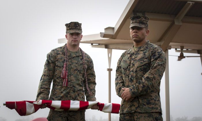 United States Marines (left) Lance Corporal Brandon James and Lance Corporal Devyn Dockery prepare to raise the national flag of the United States of America before the start of the opening ceremony of Exercise Southern Jackaroo 21 at 1st Brigade headquarters, Darwin on June 15. (PTE Jacob Joseph/ADF)
