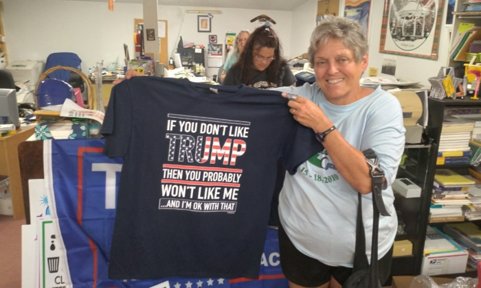 Cheri Diederich of Elyria, displays her new Trump T-shirt purchased at Special Effects Custom Printing in Wellington, Ohio, on June 25, 2021. (Courtesy of Michael Sakal)