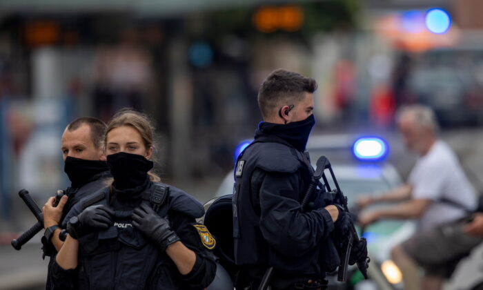 """Police secure the area during a """"major operation"""" in which police arrested a suspect after local media had earlier reported multiple stabbings, in the German town of Wuerzburg, Germany, on June 25, 2021. (Heiko Becker/Reuters)"""
