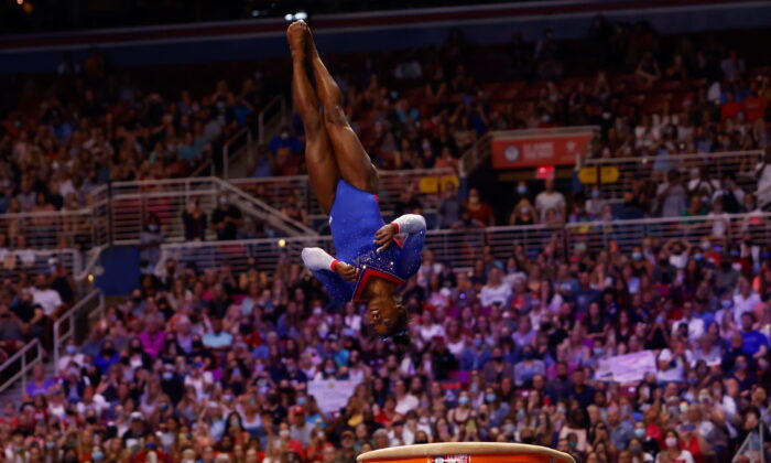 Simone Biles competes on the vault at the U.S. Women's Olympic Gymnastics trials in St Louis, Missouri, U.S., on June 25, 2021. (Lindsey Wasson/Reuters)