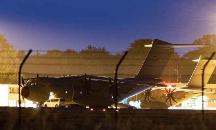 A military transport aircraft, an Airbus A400 M of the German Air Force, stands at the Wunstorf, Germany, air base in Lower Saxony before taking off for Mali on June 25, 2021. (Swen Pf'rtner/dpa via AP)