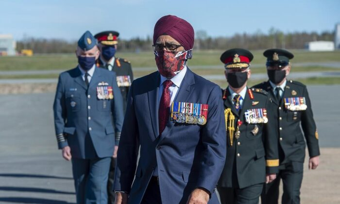 Defence Minister Harjit Sajjan is followed by Canadian Forces officers at a homecoming ceremony at Halifax Stanfield International Airport in Enfield, N.S., on May 24, 2020. (The Canadian Press/Andrew Vaughan)