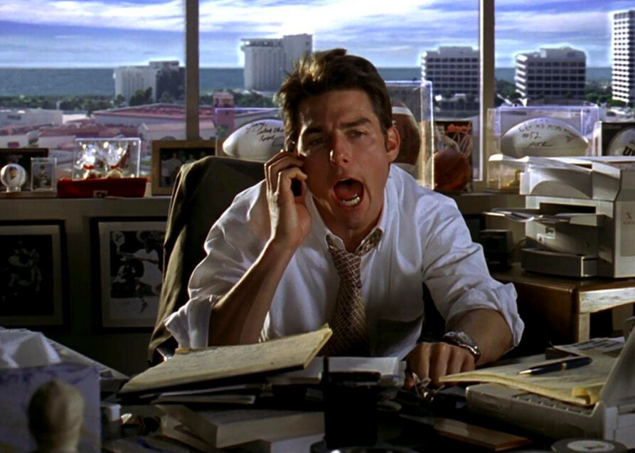 """man on phone at desk in """"Jerry Maguire"""""""