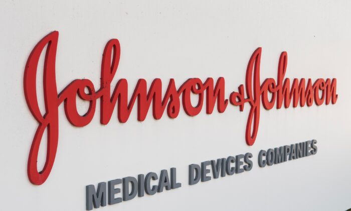 An entry sign to the Johnson & Johnson campus shows their logo in Irvine, Calif., on Aug. 28, 2019. (Mark Ralston/AFP via Getty Images)