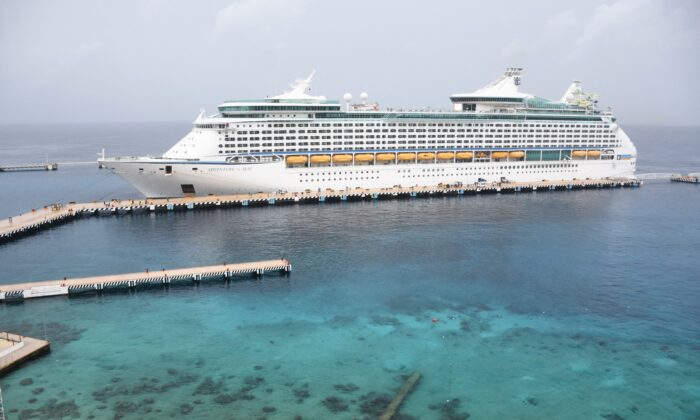 """The Royal Caribbean cruise ship """"Adventure of the Seas"""" is docked in the island of Cozumel, off the coast of Mexico's Quintana Roo State, on June 16, 2021. (Elizabeth Ruiz/AFP via Getty Images)"""