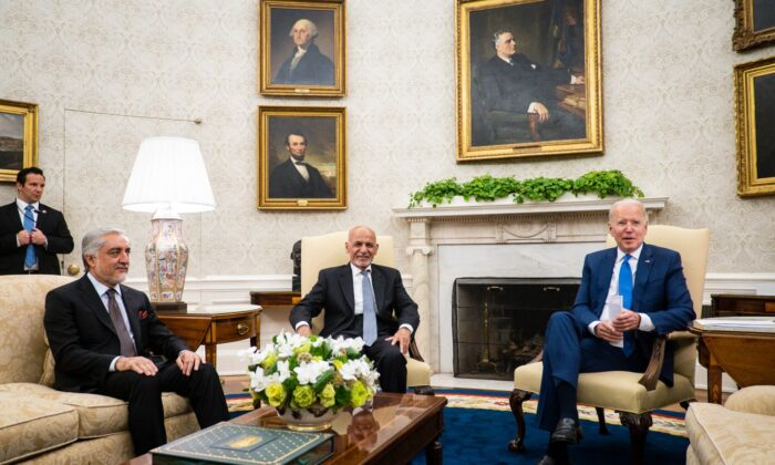 President Joe Biden (R) hosts Afghanistan President Ashraf Ghani (C) and Dr. Abdullah Abdullah, Chairman of the High Council for National Reconciliation, in the Oval Office at the White House in Washington, on June 25, 2021. (Pete Marovich/Pool/Getty Images)