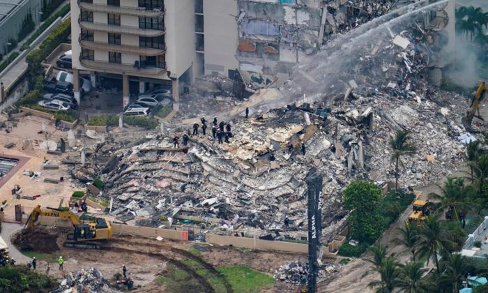 Rescue workers work in the rubble at the Champlain Towers South Condo is seen in Surfside, Fla., on June 25, 2021. (Gerald Herbert/AP Photo)