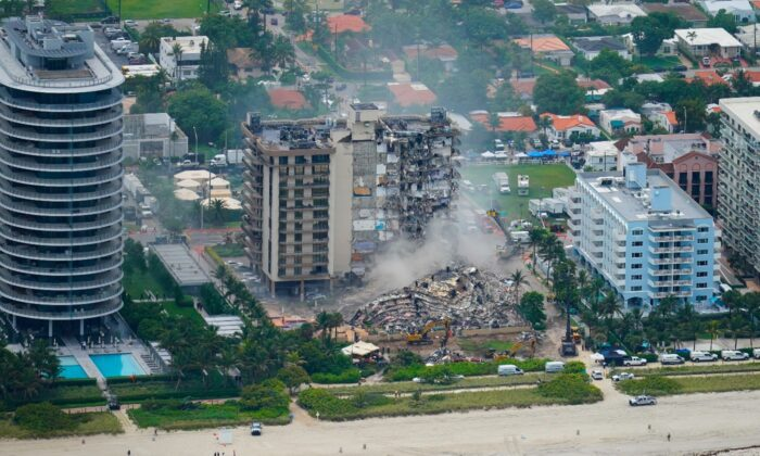 Rescue personnel work in the rubble at the Champlain Towers South Condo, in Surfside, Fla., on June 25, 2021. (Gerald Herbert/AP Photo)