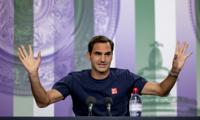 Switzerland's Roger Federer attends a press conference prior to the Wimbledon Tennis Championships in London, England, on June 26, 2021. (Florian Eisele/Pool via AP)