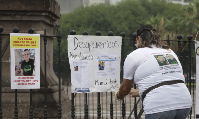 Family of Ricardo Valdes, who disappeared on the road on May 25, placed missing posters during a protest in Monterrey, Nuevo Leon state, Mexico, on June 24, 2021. (Roberto Martinez/AP Photo)