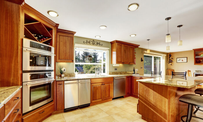 Stained wood cabinets can create a unique kitchen decor. (Artazum/Shutterstock)