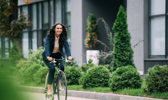 Instead of driving everywhere, lace up your sneakers—or grab your bike—and get some exercise while you save gas. (LightField Studios/Shutterstock)