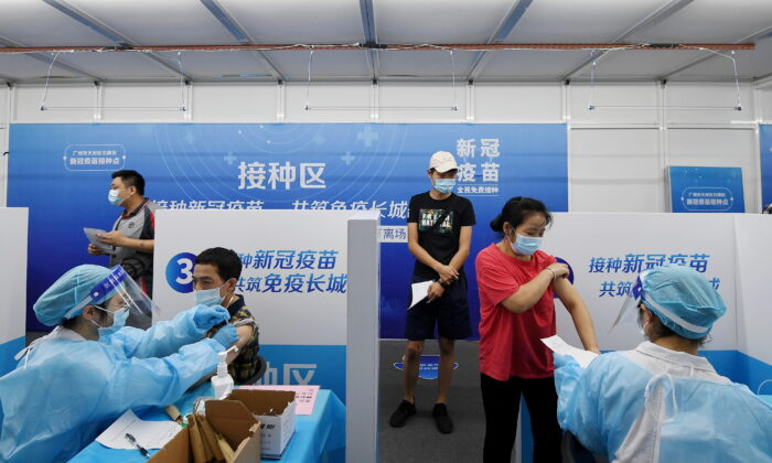 Residents receive COVID-19 vaccines at a makeshift vaccination site in Guangzhou, Guangdong Province, China on June 21, 2021. (Cnsphoto via Reuters)