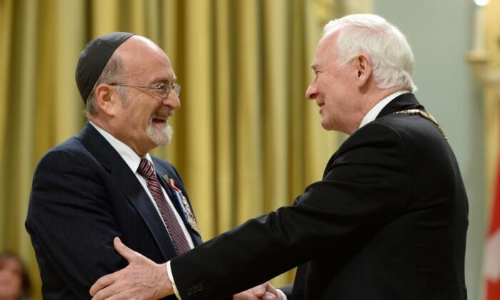 Governor General David Johnston invests Rabbi Reuven Bulka of Ottawa into the Order of Canada to during a ceremony at Rideau Hall in Ottawa on May 7, 2014. (The Canadian Press/Sean Kilpatrick)