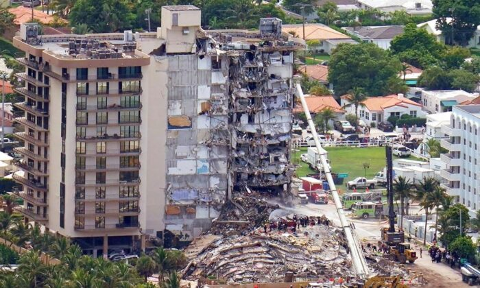 Workers search in the rubble at the Champlain Towers South Condo in Surfside, Fla., on June 26, 2021. (Gerald Herbert/AP Photo)