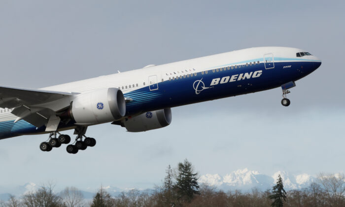 A Boeing 777X airplane takes off during its first test flight from the company's plant in Everett, Wash., on Jan. 25, 2020. (Terray Sylvester/Reuters)