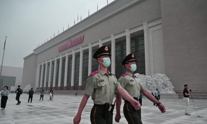 Chinese police officers walk outside the newly built Museum of the Communist Party of China in Beijing on June 25, 2021. (Kevin Frayer/Getty Images)