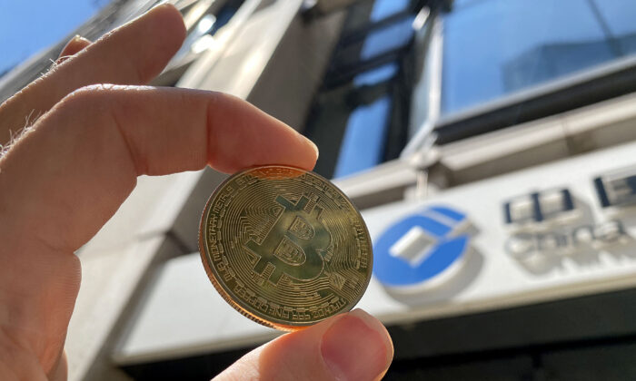 In this photo illustration, a visual representation of Bitcoin cryptocurrency is pictured in London on May 30, 2021. (Edward Smith/Getty Images)