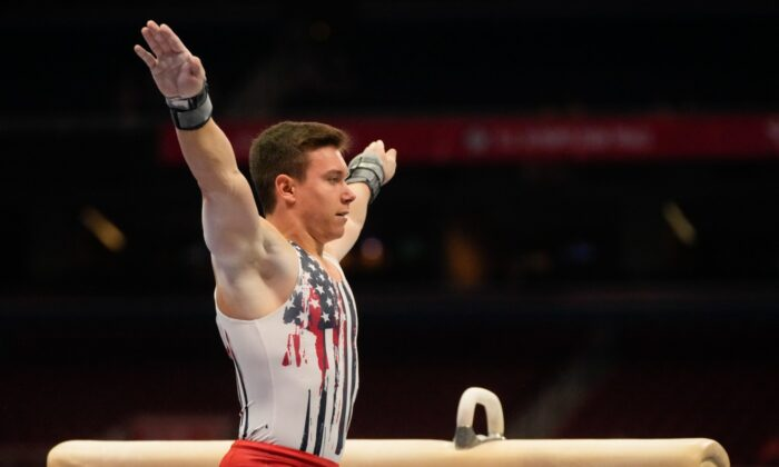 Brody Malone lands after competing on the pommel horse during the men's U.S. Olympic Gymnastics Trials, in St. Louis, on June 26, 2021. (Jeff Roberson/AP Photo)