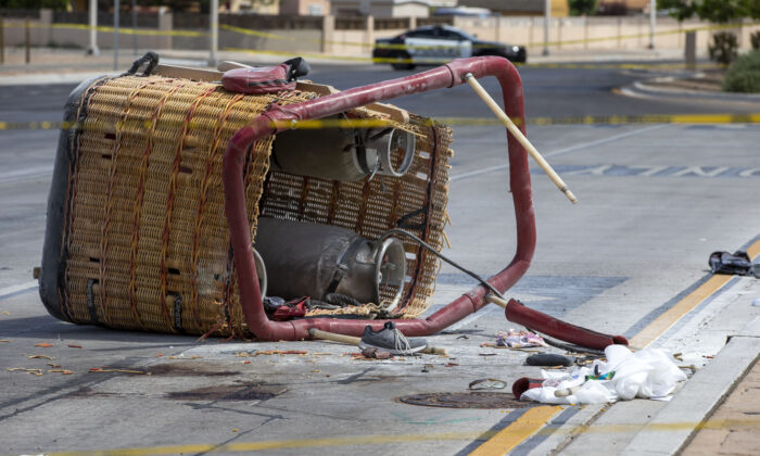 The basket of a hot air balloon which crashed lies on the pavement in Albuquerque, N.M., on June 26, 2021. (Andres Leighton/AP Photo)