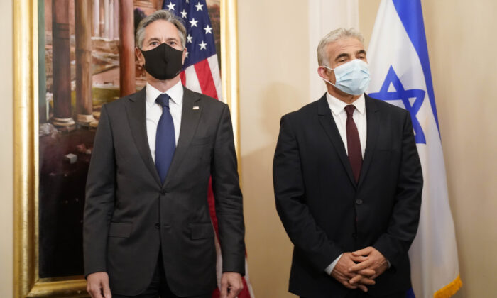 Secretary of State Antony Blinken (L) and Israeli Foreign Minister Yair Lapid pose for a family picture during their meeting in Rome, on June 27, 2021. (Andrew Harnik/Pool/AP Photo)