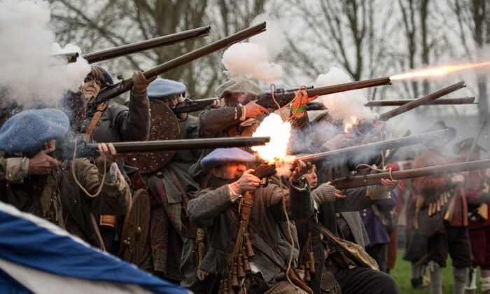 Members of the Sealed Knot, a society promoting interest in the English Civil War, fire muskets as they stage a reenactment of the Battle of Nantwich, a battle which took place near the town in 1644, in north west England on Jan. 25, 2020. The first modern re-enactment of the Battle of Nantwich took place in 1973 and has taken place every year since. In January 1643, Parliamentarians took the town of Namptwiche (Cheshires second town). By the end of December, the town was surrounded by Royalists and under siege. A Parliamentarian force marched south from Lancashire under the command of Sir Thomas Fairfax and defeated the Royalists in the Battle of Namptwiche on Jan. 25, 1644. (Oli Scarff/AFP via Getty Images)