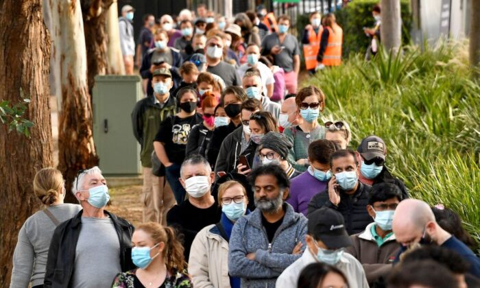 Sydneysiders queue outside a vaccination centre in Sydney, Australia on June 24, 2021. (Saeed Khan/AFP via Getty Images)
