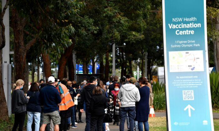 Sydneysiders queue outside a vaccination centre for their dose of vaccine in Sydney, Australia on June 24, 2021. (Saeed Khan/AFP via Getty Images)