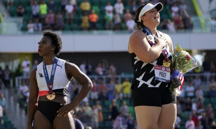 Gwendolyn Berry (L), looks away as DeAnna Price stands for the national anthem after the finals of the women's hammer throw at the U.S. Olympic Track and Field Trials in Eugene, Ore., on June 26, 2021. (Charlie Riedel/AP Photo)