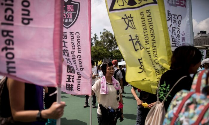 A protester holds a flag ahead of the pro-democracy march in Hong Kong on July 1, 2015. (Anthony Kwan/Getty Images)
