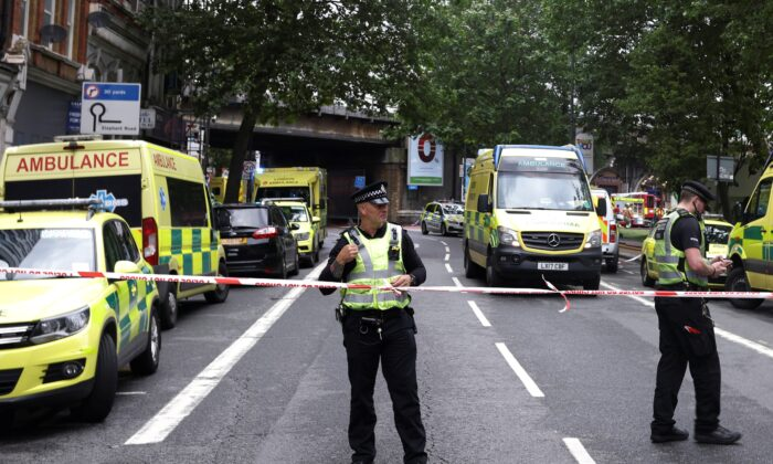 Emergency crews attend to a scene of fire near the Elephant and Castle train station in London, Britain, on June 28, 2021. (Henry Nicholls/Reuters)