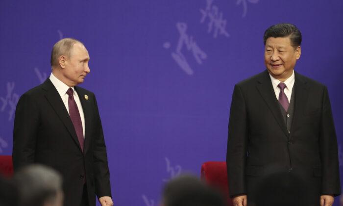 Russian President Vladimir Putin (L) and Chinese leader Xi Jinping (R) attend the Tsinghua University's ceremony at Friendship Palace in Beijing, China, on April 26, 2019. (Kenzaburo Fukuhara/Pool/Getty Images)
