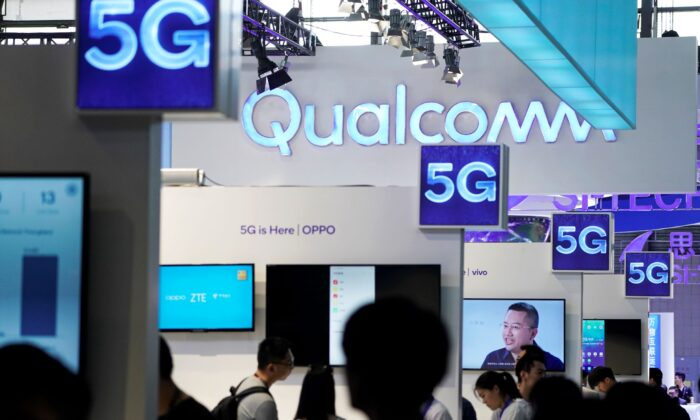 Signs of Qualcomm and 5G at Mobile World Congress (MWC) in Shanghai, China, on June 28, 2019. (Aly Song/Reuters)