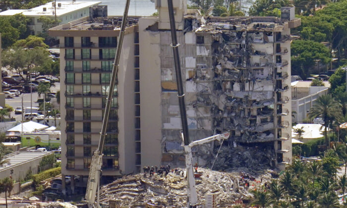 This aerial image shows an oceanfront condo building that partially collapsed on June 24, with many people still unaccounted for, in Surfside, Fla., on June 27, 2021. (Gerald Herbert/AP Photo)